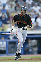 Rich Aurilia of the San Francisco Giants bats during a 2002 MLB season game against the Los Angeles Dodgers at Dodger Stadium, in Los Angeles, California. (Larry Goren/Four Seam Images)