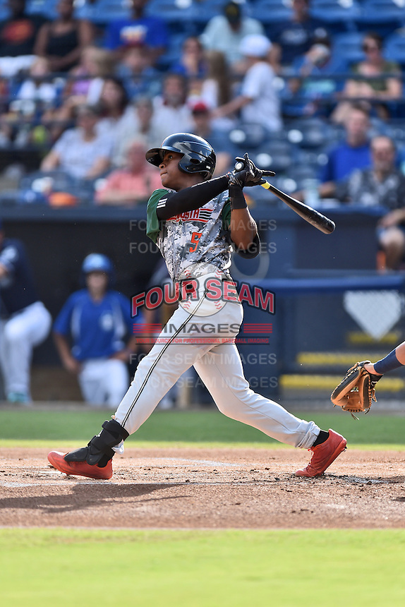Augusta GreenJackets second baseman Jalen Miller (5) swings at a pitch during a game against the Asheville Tourists at McCormick Field on August 6, 2016 in Asheville, North Carolina. The GreenJackets defeated the Tourists 11-4. (Tony Farlow/Four Seam Images)