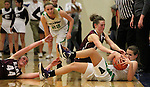 From left, Elko's RaeLynn Forcella and Virgin Valley's Alora Bonner look on as Elko's Sierra Dumas and Virgin Valley's Josie Grajek fight for a loose ball during a semi-final game in the NIAA 3A State Basketball Championships between Virgin Valley and Elko high schools at Reno High School in Reno, Nev, on Friday, Feb. 24, 2012. Elko won 49-32..Photo by Cathleen Allison