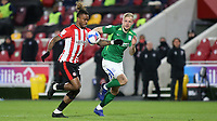 Ivan Toney of Brentford controls the ball under pressure from Birmingham's Marc Roberts during Brentford vs Birmingham City, Sky Bet EFL Championship Football at the Brentford Community Stadium on 6th April 2021
