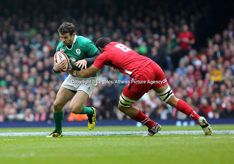 Pictured: Jared Payne of Ireland (L) tackled by Taulupe Faletau of Wales (R) Saturday 14 March 2015<br /> Re: RBS Six Nations, Wales v Ireland at the Millennium Stadium, Cardiff, south Wales, UK.