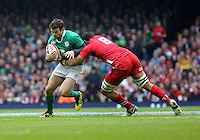 Pictured: Jared Payne of Ireland (L) tackled by Taulupe Faletau of Wales (R) Saturday 14 March 2015<br />