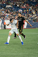 FOXBOROUGH, MA - AUGUST 4: Eddie Segura #4 of Los Angeles FC leaps for a head ball during a game between Los Angeles FC and New England Revolution at Gillette Stadium on August 3, 2019 in Foxborough, Massachusetts.