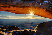 Mesa Arch Sunrise. Mesa Arch is one of the most photographed locations in Canyonlands National Park near Moab. Most western landscape shooters have this on their shot list or already in the bag. In many classic images of this event, you will notice the sun positioned to the left side of the arch. I wanted to shoot this close to the Winter Solstice when the sun was far to the south and did so on December 27, 2012. Standing alongside my son, J.C. Lansche - and a small cadre of international photographers - on a 5 degree morning made it special. This was the the beginning of a 5 day winter camping trip with J.C. through the desert southwe