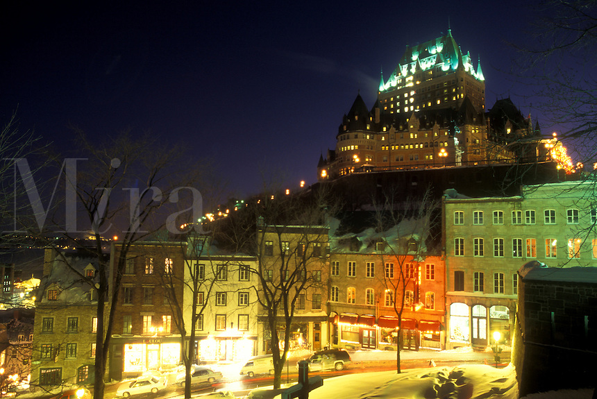 AJ0678, Canada, Quebec, Chateau Frontenac illuminated at night (evening) from Parc Montmorency in winter in Old Quebec City.