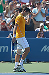 """Novak Djokovic (SRB) """"celebrates"""" his victory over Alexandr Dolgopolov (UKR) 4-6, 7-6, 6-2 at the Western and Southern Open in Mason, OH on August 22, 2015."""