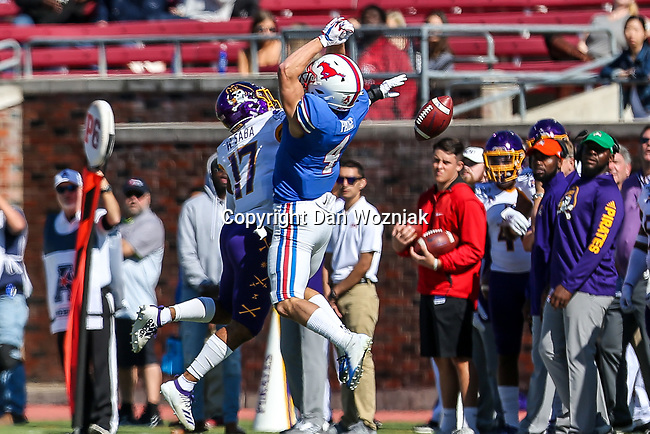 Southern Methodist Mustangs wide receiver Tyler Page (4) and East Carolina Pirates linebacker Warren Saba (17) in action during the game between the East Caroline Pirates  and the SMU Mustangs at the Gerald J. Ford Stadium in Fort Worth, Texas.