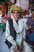 Rajasthan, India. Ranthambore National Park. Shawl salesman in green turban.
