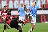 Franck Kessie of AC Milan and Lucas Leiva of SS Lazio compete for the ball during the Serie A 2021/2022 football match between AC Milan and SS Lazio at Giuseppe Meazza stadium in Milano (Italy), August 29th, 2021. Photo Image Sport / Insidefoto