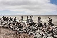 Rock Balancing - an art form or hobby.  Rocky creations rise along the rocky shores of the San Leandro Marina on San Francisco Bay.
