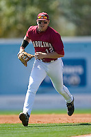 South Carolina first baseman Justin Smoak (12) charges to the plate as the LSU batter squares to bunt at Sarge Frye Stadium in Columbia, SC, Thursday, March 18, 2007.