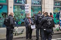 """Sogenannten """"Querdenker"""" sowie verschiedene rechte und rechtsextreme Gruppen hatten fuer den 18. November 2020 zu einer Blockade des Bundestag aufgerufen. Sie wollten damit verhindern, dass es eine Abstimmung ueber das Infektionsschutzgesetz gibt.<br /> Es sollen sich ca. 7.000 Menschen versammelt haben. Sie wurden durch Polizeiabsperrungen daran gehindert zum Reichstagsgebaeude zu gelangen. Sie versammelten sich daraufhin u.a. vor dem Brandenburger Tor.<br /> Im Bild: Ein Demonstrant wird von der Polizei durchsucht.<br /> 18.11.2020, Berlin<br /> Copyright: Christian-Ditsch.de"""