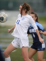 Rogers' Allison Golden (11) controls the ball Tuesday, April 27, 2021, as Springdale Har-Ber's Natalie Hathorn defends during the first half of play at Wildcat Stadium in Springdale. Visit nwaonline.com/210428Daily/ for today's photo gallery. <br /> (NWA Democrat-Gazette/Andy Shupe)