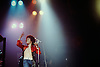 """Leo Sayer performing at Worthing Town Hall in 1975.<br /> <br /> Leo Sayer (born Gerard Hugh Sayer, 21 May 1948) is a British-born singer-songwriter musician, and entertainer (now an Australian citizen and resident) whose singing career has spanned four decades. Sayer launched his career in the UK in the early 1970s and became a top singles and album act on both sides of the Atlantic in the 1970s. His first seven hit singles in the United Kingdom all reached the Top 10 – a feat first registered by his first manager, Adam Faith. His songs have been sung by other notable artists, including Cliff Richard's, """"Dreamin'"""".<br /> <br /> Sayer began his music career co-writing songs with David Courtney, including """"Giving it All Away"""", which gave Roger Daltrey of The Who his first hit without The Who in 1973. The same year, Sayer began his career as a recording artist under the management guidance of Adam Faith, who signed Sayer to the Chrysalis label in the UK and Warner Bros. Records in the USA. His debut single """"""""Why Is Everybody Going Home"""" failed to chart, but he shot to national prominence in the UK with his second single, the plaintive music hall-styled song """"The Show Must Go On"""", which Sayer memorably performed on British television wearing a pierrot costume and make-up. The single went quickly to #2 on the UK chart, as did his debut album Silverbird, for which Sayer wrote nine of the eleven tracks; the other two tracks were co-written with Courtney, who co-produced the album with Adam Faith.<br /> <br /> Stock Photo by Paddy Bergin"""