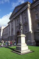 AJ0956, Europe, Republic of Ireland, Ireland, Dublin. A statue stands on a lush green lawn at the entrance to Trinity College, founded in 1592, in Dublin in County Dublin.