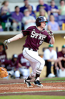 Mississippi State second baseman Matthew Britton #15 singles against the LSU Tigers during the NCAA baseball game on March 17, 2012 at Alex Box Stadium in Baton Rouge, Louisiana. The 10th-ranked LSU Tigers beat #21 Mississippi State, 4-3. (Andrew Woolley / Four Seam Images).