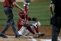 Arkansas outfielder Christian Franklin (25) reacts following an minor injury, Saturday, June 5, 2021 during the first inning in the second game of the NCAA Fayetteville Regional at Baum-Walker Stadium in Fayetteville. Check out nwaonline.com/210606Daily/ for today's photo gallery. <br /> (NWA Democrat-Gazette/Charlie Kaijo)