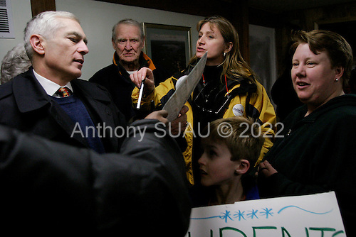 Strafford, New Hampshire.January 26, 2004..General Wesley Clark campaigns hour before the polls open. Here he visits Iginglass country store.