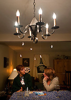 Kara and her sister talk after a family dinner at their parents' house. Photo by James R. Evans ©