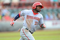 Harrisburg Senators outfielder Brian Goodwin #23 runs to first during a game against the Erie Seawolves on July 2, 2013 at Jerry Uht Park in Erie, Pennsylvania.  Erie defeated Harrisburg 2-1.  (Mike Janes/Four Seam Images)
