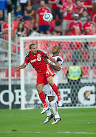28 August 2010: Real Salt Lake defender Jamison Olave #4 and Toronto FC forward Dwayne De Rosario #14 in action during a game between Real Salt Lake and Toronto FC at BMO Field in Toronto..The game ended in a 0-0 draw..