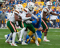 Miami Hurricanes quarterback N'Kosi Perry (5) gets tackled by Pitt linebacker Kylan Johnson (28). The Miami Hurricanes football team defeated the Pitt Panthers 16-12 in a game at Heinz Field, Pittsburgh, Pennsylvania on October 26, 2019.