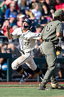 Michigan Wolverines outfielder Jordan Brewer (22) rounds third base against the Vanderbilt Commodores during Game 1 of the NCAA College World Series Finals on June 24, 2019 at TD Ameritrade Park in Omaha, Nebraska. Michigan defeated Vanderbilt 7-4. (Andrew Woolley/Four Seam Images)