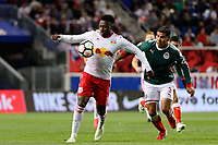 Harrison, NJ - Tuesday April 10, 2018: Derrick Etienne Jr., Carlos Salcido during leg two of a  CONCACAF Champions League semi-final match between the New York Red Bulls and C. D. Guadalajara at Red Bull Arena. C. D. Guadalajara defeated the New York Red Bulls 0-0 (1-0 on aggregate).