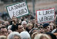 """Se non le donne chi? Se non ora quando?"": manifestazione per il rispetto della dignita' e dei diritti delle donne, a Roma, 11 dicembre 2011..Women attend the ""If not women who? If not now, when?"" rally to ask for respect of their dignity and rights, in Rome, 11 december 2011. The signs read ""Slavery is free"" and ""Work has to be paid""..UPDATE IMAGES PRESS/Riccardo De Luca"