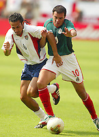 Pablo Mastroeni tries to win the ball from Cuauhtemoc Blanco. The USA defeated Mexico 2-0 in the Round of 16 of the FIFA World Cup 2002 in South Korea on June 17, 2002.
