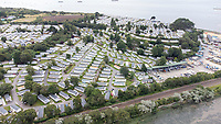 BNPS.co.uk (01202) 558833. <br /> Pic: BNPS<br /> <br /> Pictured: Holiday homes at Rockley Park at Rockley Point in Poole Harbour, Dorset. <br /> <br /> A grieving mother who complained to a caravan park about the lack of safety measures at a beach where her son drowned has been offered a free holiday in response.<br /> <br /> Callum Osborne-Ward, 18, was swept away in front of his family moments after rescuing several children from a deadly riptide at Rockley Point in Poole Harbour, Dorset, last month.<br /> <br /> His devastated mother Ann Marie Osborne has since criticised holiday firm Haven, which owns the caravan park backing onto the waterway, for failing to warn visitors about the hidden riptide and advertising the beach on its website.