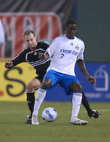Kansas City Wizards forward Eddie Johnson (7) holds the ball in front of DC United defender Bryan Namoff (26). The Kansas City Wizards defeated DC United 4-2, in the home opening game for DC United at RFK Stadium, April 14, 2007.