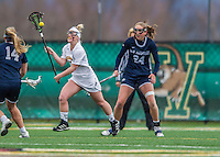 25 April 2015: University of Vermont Catamount Defender Meghan Cobb, a Sophomore from Wilmington, DE, in action against the University of New Hampshire Wildcats at Virtue Field in Burlington, Vermont. The Lady Catamounts defeated the Lady Wildcats 12-10 in the final game of the season, advancing to the America East playoffs. Mandatory Credit: Ed Wolfstein Photo *** RAW (NEF) Image File Available ***