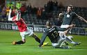 Dundee Utd's David Goodwillie scores their first goal.