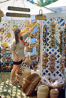 Vendor arranging baskets at Corvallis Fall Festival, Oregon.