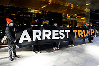 NEW YORK, NEW YORK - MARCH 08: A small group of people hold a placard during a protest against the former U.S. president Donald Trump at Trump Tower on March 08, 2021 in New York. Trump is returning to New York for the first time after leaving the White House at a time when several New York prosecutors are investigating his businesses for possible fraud crimes. (Photo by John Smith/VIEWpress)