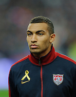 Danny Williams of team USA stands for the national anthem prior to the friendly match France against USA at the Stade de France in Paris, France on November 11th, 2011.