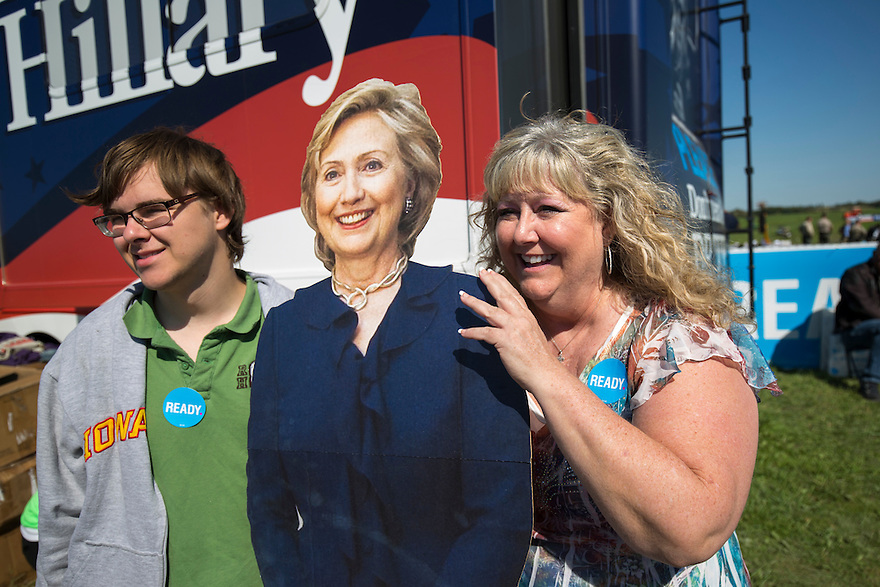 Supporters pose with a cardboard cut out of Hillary Clinton at the Tom Harkin's  Steak Fry in Indianola,  Iowa