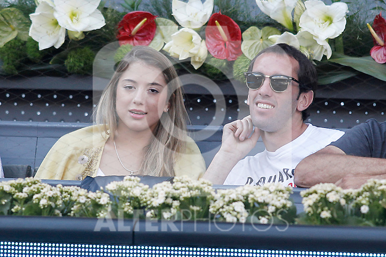 Atletico de Madrid's player Diego Godin with his wife during Madrid Open Tennis 2015 match.May, 8, 2015.(ALTERPHOTOS/Acero)