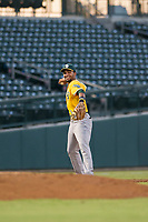 AZL Athletics third baseman Yerdel Vargas (5) warms up between innings during a game against the AZL Cubs on August 9, 2017 at Sloan Park in Mesa, Arizona. AZL Athletics defeated the AZL Cubs 7-2. (Zachary Lucy/Four Seam Images)