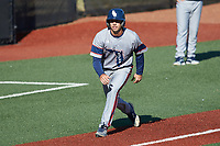 Wilfredo Alvarez (4) of the Florida Atlantic Owls takes his lead off of third base against the Charlotte 49ers at Hayes Stadium on April 2, 2021 in Charlotte, North Carolina. The 49ers defeated the Owls 9-5. (Brian Westerholt/Four Seam Images)