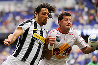 Carvalho de Oliveira Amauri (11) of Juventus F. C. and Luke Sassano (32) of the New York Red Bulls. The New York Red Bulls defeated Juventus F. C. 3-1 during a friendly at Red Bull Arena in Harrison, NJ, on May 23, 2010.