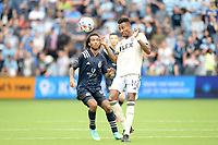KANSAS CITY, KS - JUNE 26: Mark-Anthony Kaye #14 Los Angeles FC heads the ball during a game between Los Angeles FC and Sporting Kansas City at Children's Mercy Park on June 26, 2021 in Kansas City, Kansas.