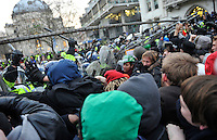 Protestors try to break down the barriers on Parliament Square during a student demonstration in Westminster, central London on the day the government passed a bill to increase university tuition fees.