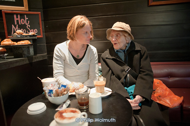 96 year-old Vivien Pixner suffers from age-related macular degeneration and can no longer read, or leave her flat without help.  Through Age Concern Camden's Good Neighbours Scheme, volunteer Debbie Lythe, a secondary school teacher, visits once a week to accompany her to a local cafe and to read and discuss  her chosen books.  The scheme is threatened with closure following government cuts to Camden Council's funding.
