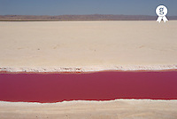 Tunisia, Chott el Jerid, red stream of water in dry salt lake (Licence this image exclusively with Getty: http://www.gettyimages.com/detail/sb10065474cv-001 )
