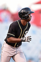 Omaha Storm Chasers outfielder Melky Mesa (22) watches the ball while running to first after hitting a home run during a game against the Nashville Sounds on May 19, 2014 at Herschel Greer Stadium in Nashville, Tennessee.  Nashville defeated Omaha 5-4.  (Mike Janes/Four Seam Images)