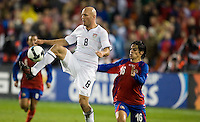 Conor Casey volleys the ball during a 2-2 tie with Costa Rica to put the USA in first place of .CONCACAF 2010 World Cup qualifying, at RFK Stadium, in Washington DC, Wednesday, October 14, 2009.