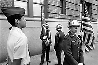 """USA. New York City. Young army cadets pay their tribute to the soldiers who have served in armed service also known as Vietnam veterans and to those who die on duty. The national flag of the United States of America, often simply referred to as the American flag, consists of thirteen equal horizontal stripes of red (top and bottom) alternating with white, with a blue rectangle in the canton (referred to specifically as the """"union"""") bearing fifty small, white, five-pointed stars arranged in nine offset horizontal rows of six stars (top and bottom) alternating with rows of five stars. The 50 stars on the flag represent the 50 states of the United States of America and the 13 stripes represent the thirteen British colonies that declared independence from the Kingdom of Great Britain and became the first states in the Union. Nicknames for the flag include the """"Stars and Stripes"""", """"Old Glory"""", and """"The Star-Spangled Banner. © 1986 Didier Ruef"""