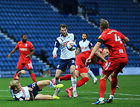 31st October 2020; Deepdale Stadium, Preston, Lancashire, England; English Football League Championship Football, Preston North End versus Birmingham City; Tom Barkhuizen of Preston North End attempts to control the ball challenged by Marc Roberts of Birmingham City